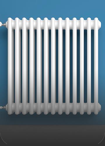 Biały grzejnik naniebieskiej ścianie